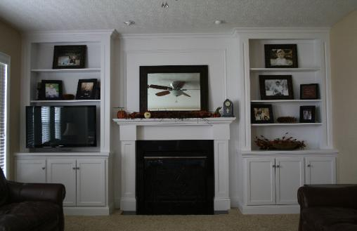 Living room remodel. Painted fireplace mantle with bookcases