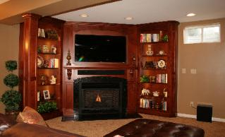Fireplace mantle with flat screen tv and bookcases, buil in,